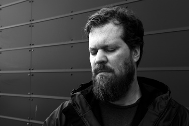 John Grant's story has become familiar with Icelanders and his fans worldwide. Former frontman of Denver-based rock group, The Czars, he launched his solo career in 2010 with the masterpiece Queen of Denmark, with lyrics that struck your core as he revealed the darkness in his life, depression, drug addiction and HIV diagnosis. Soon after, he popped up in Iceland, with his second album sporting a photo of him sitting in the legendary Kaffi Mokka on Skólavörðustígur. Pale Green Ghosts was co-written by Biggi Veira, an Icelandic electronic musician, and John toured the world with a mostly Icelandic entourage.