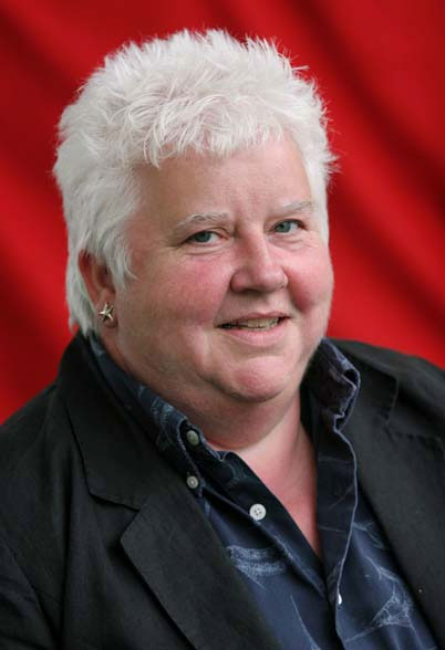 Val McDermid is a best-selling crime writer from Kirkcaldy, Fife. She was the first student from a state school in Scotland to attend St. Hilda's College at the University of Oxford. Later she became a journalist before publishing her first crime novel in 1987 but still contributes to several British newspapers and sometimes broadcasts on BBC radio. She is co-founder of the Harrogate Crime Writing Festival and was awarded an honorary doctorate from the University of Sunderland in 2011.
